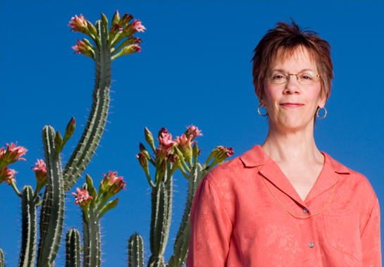 Woman with pink Cactus Flowers in Back